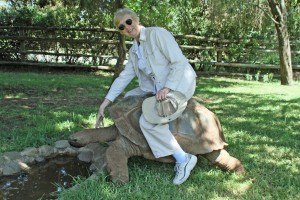 mom rides a 150 year old turtle.