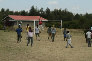 The kids on our tour join the kids at the center for a game of soccer.