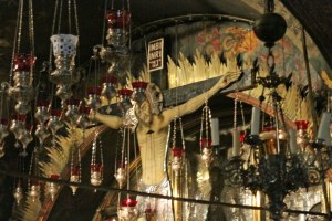 The lavish decorations above the altar of the rock of crucifixion.