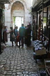 The Via Dolorosa, monks, shops and more outside the Church of Holy Sepulcher.