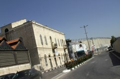 A massive wall with barbed wire separates the inhabitants of Bethlehem and Jerusalem.
