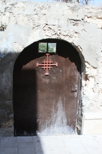 A door at the church in Cana with the Franciscan cross.