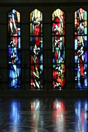 A reflective wall of stain-glass windows in the Church of Annunciation.