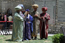 Some actors in the courtyard of the Palace.